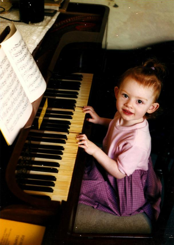 Dorothea at the restored 1838 Tomlinson square piano on her 2nd birthday